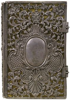 Metal cover anyone?                                                            New Testament Silver metal on black leather Binder unknown, 1710