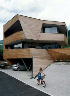 Twisted timber clad form with cuts