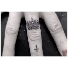 Dr Woo tiny detailed crown finger tattoo