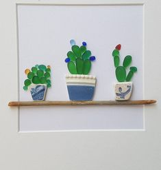 This sea glass art is a gorgeous and unique handmade picture of three sea glass succulent plants in beautiful sea pottery plant pots. There are two different pictures to choose from 1. 3 plants without driftwood 2. 3 plants with driftwood. Images above. Please select which you require.