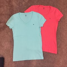 Tommy Hilfiger - pair of shirts, never worn, Sz M Pair of v-neck Aqua and coral color Tommy Hilfiger shirts. Women's size M. Never worn but washed once. Each one was purchased $24.50. Tommy Hilfiger Tops Tees - Short Sleeve