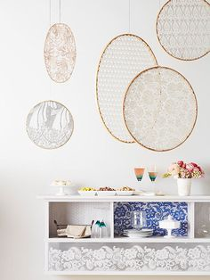 We love the idea of hanging a lace mobile over your bar cart! Find more DIY ideas here: http://www.bhg.com/decorating/do-it-yourself/accents/budget-friendly-diy-projects/?socsrc=bhgpin012615lacemobile&page=10