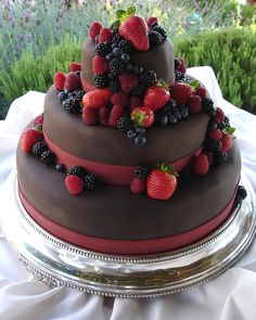 Chocolate fondant, fresh organic berries, and deep red bands,  in keeping with the bridal party's fall wedding colors,  covered a spectacular chocolate and fruit-filled cake.