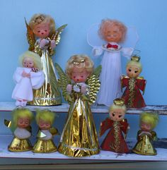Assortment of vintage angels in all shapes and sizes. Two tall gold angels. Rubber heads with gold wings in good condition. Japan sticker on both 8