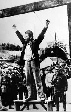 """Partisan fighter Stjepan Stevo Filipović shouting """"Death to fascism, freedom to the People"""" seconds before his execution by a Serbian State Guard unit in Valjevo, occupied Yugoslavia. WW2"""
