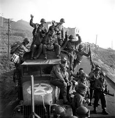 Army troops rejoice upon reaching Italian soil after their beachhead landings at Anzio (Operation Shingle) during the Italian Campaign. The Battle of Anzio would commence on 22 January Military Photos, Military History, Military Dogs, South East Europe, Italian Campaign, Human Rights Issues, History Images, United States Army, American Soldiers