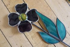 Here's another one of Gene Moor's stained glass flowers.  They can add color to any garden or flower pot - and they never fade!  They make perfect hostess gifts.  Available at the Looking Glass Museum Store.
