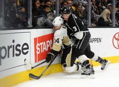 Face first:   Los Angeles Kings defenseman Brayden McNabb (3) hits Pittsburgh Penguins left wing Chris Kunitz (14) against the boards during the third period at Staples Center on Dec. 5 Los Angeles.  -  © Gary A. Vasquez/USA TODAY Sports