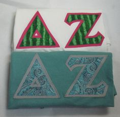One of our on sale packs, available now. Click through to see how many are available (usually one) and for more information on the items included. It's practically a steal! Greek Shirts, Custom Greek Apparel, Sorority Outfits, Delta Zeta, Greek Clothing, Bid Day, White Letters, Screen Printing, Packing
