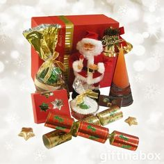 Christmas gift hamper with singing Santa & other Christmas treats. Singing Santa Gifts delivery to South Africa. Mini Christmas Cakes, Christmas Crackers, Christmas Bells, Christmas Treats, Chocolate Stars, Chocolate Filling, Christmas Chocolate, Hamper Boxes, Gift Hampers
