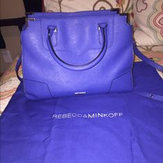 Rebecca Minkoff Amorous leather satchel As all of my items, this is authentic. A beautiful royal blue color, this real leather purse is spacious and fashionable. Bag is in amazing condition apart from the wear and tear shown in pictures 3&4. Priced fairly and accordingly. Comes from a smoke and pet free home. Rebecca Minkoff Bags