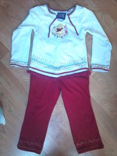 one of my favorite outfits just because of the details. fringed bottom shirt with embroidered details in a soft white cotton knit, blanket stitch neck and ribbon closure. Soft matching red knit pants with embroidered details at hem