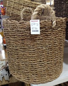 Lots of great baskets like these at Homegoods for around $20 ea; great for dropping diaper bag, purse and baby gear when you walk in the door