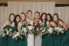 Cedarbrook Lodge wedding in Seattle | Wintery wedding bouquets with dark red roses, ferns, and dusty miller | Perfectly Posh Events | Carly Bish Photography | Butter & Bloom