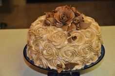 I made this Chocolate Rosette Cake with Chocolate Fondant Roses for our church youth fundraiser!  By WFSamiam on CakeCentral.com