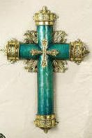 Jade colored cross with metallic flourishes.