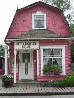 love the fancy shingle design & the stained glass windows....& of course, it's pink...