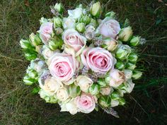 An understated and stylish wedding bouquet for brides who love the vintage look. These spectacular multi-bloom vintage pink and cream roses are mixed with wild mint to create a soft and laid-back hand-tied posy. Designed in the UK by www.sophietownsend.com
