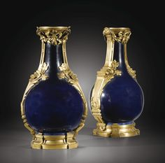 A PAIR OF GILT-BRONZE MOUNTED CHINESE PORCELAIN VASES IN LOUIS XVI STYLE Height 15 3/4 in; width 8 2/3 in