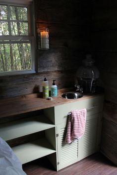 rustic, no-running-water sink. Note the myers soaps...check if they are biodegradeable for septic systems