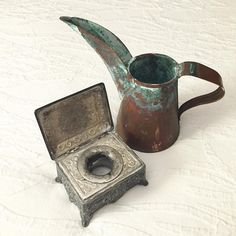 Vintage penmanship treasures: Victorian inkwell with acanthus leaf engraving (circa 1860-1885) and a copper ink pitcher used for filling schoolroom inkwells. #iampeth2015