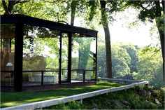 ...stay in this beautiful glass home and wake up among the trees...sigh.