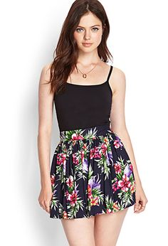 I bought this in hot pink and the color is gorge against my skin.  Looks cute with my cropped bustier from Aero.