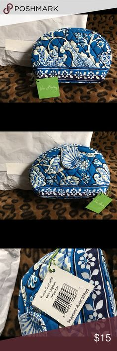NWT Vera Bradley Pocket Cosmetic Pouch Blue Lagoon Has been in box since purchased. Awesome pouch that you can throw in a purse, diaper bag or luggage. Waterproof interior would be great for your cosmetics. Two netted pockets help with organizing items inside. Would be a great catchall for your earbuds, charging cables or mobile device accessories. One exterior pocket with a magnetic closure. Vera Bradley Bags Cosmetic Bags & Cases