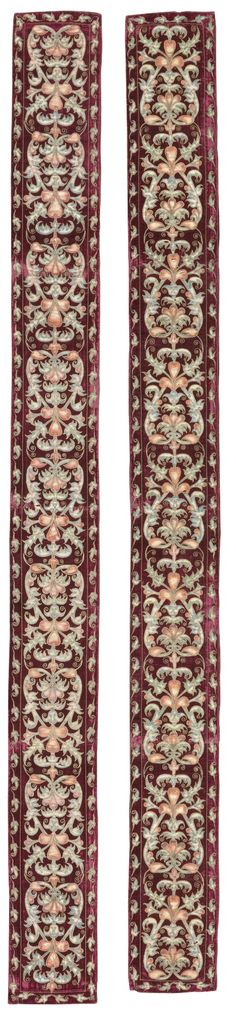 A pair of cerise velvet, metal-thread and painted silk appliqué strips, probably…
