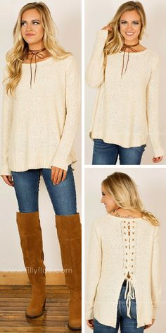 This beautifully soft sweater features an elegant lace-up detailing at the back and a comfortable relaxed fit!