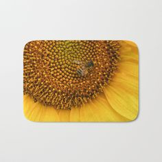 The perfect Bath Mats: fuzzy, foamy and finely enhanced with brilliant art. Featuring a soft, quick-dry microfiber surface, memory foam cushion and skid-proof backing. Time to lose that ratty shower rug and update your bathroom.      - Available in two sizes   - Soft, fuzzy microfiber surface    - Memory foam cushioning   - Skid-proof backing   #sunflower #flower #bee #art #decor #photography #bath #bathroom #mat #rug #bathrug #bathmat #accessories