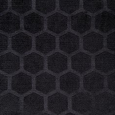Waverly Symmetry Onyx Fabric is a polyester velvet fabric from the Earthly Elegance Collection. This fabric features embossed hexagons and an incredibly soft hand.