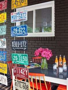 License plates can be used for a variety of things, some decorative and others both decorative and functional. In this outdoor living space, designer Brian Patrick Flynn used several vintage license plates, small metal chains and S hooks to create a colorful and eclectic room divider.