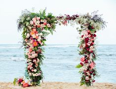 Stunning flower arch for beach wedding | Romantic Pink Hawaii Beach Elopement via @IBTblog, pics by Absolutely Loved Photography