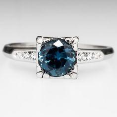 Vintage Montana Sapphire Engagement Ring--Eragem. Spectacular setting, lovely stone.