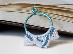 micro macrame pendant in icy colors, knotted pendant with beads and wire on steel necklace, macrame jewelry