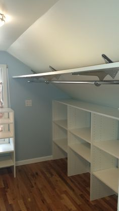 Angled brackets used to maximize space in attic closet.