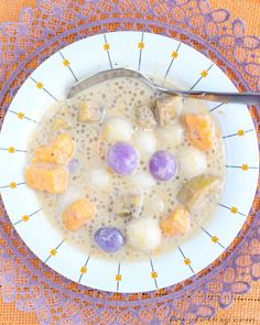 Try this easy Ginataang Bilo bilo recipe. A sweet Filipino snack/dessert of sticky rice balls, tapioca pearls and mixed fruits cooked in coconut milk.