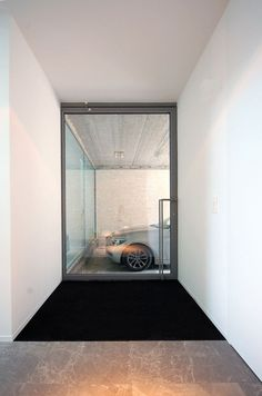 House in Mechelen is a minimalist house located in Mechelen, Belgium, designed by Areal Architecten. The residence is located in a city clos. Garages, Architecture Details, Interior Architecture, Glass Cabinet Doors, Glass Doors, Garage Interior, Entrance Doors, Minimalist Home, Modern Interior Design