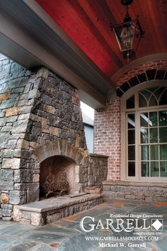 Outdoor fireplace of the Rivercrest Manor Outdoor Stone Fireplaces, Outdoor Living Areas, Outdoor Spaces, Living Spaces, Fireplace Lighting, Home Decoracion, Rustic Patio, Traditional House Plans, Craftsman Style House Plans