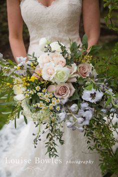 This beautifully wild and elegant wedding bouquet belonged to Vicky's on her wedding day to Dan at Cripps Barn.
