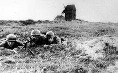 German parachute troops man a machine gun post in the Netherlands, on June 2, 1940. This photo came from a camera found on German parachute troops who were taken prisoner. (AP Photo)