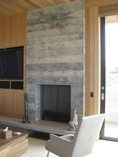 Fireplace surround is board-formed concrete - looks as natural and beautiful as marble! -modern living room Modern Living Room