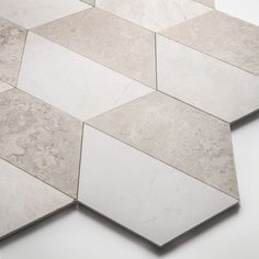 Inspired by the architecture of New York, the new Gramercy Park collection offers a versatile range of marble slab, tiles and décors. It includes contemporary marble tiles in eye-catching geometric patterns alongside plain honed surfaces. Available in a palette of 3 colourways – ivory, soft grey and veined black, the collection is designed as a suite of surfaces to be used in combination or individually. Slab options, ideal for skirtings, architraves, vanities and shower trays also available. Grey Marble Tile, Marble Stairs, Gramercy Park, Architrave, Ivory, Geometric Patterns, Contemporary, Architecture, Shower Trays