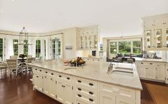 Traditional Kitchen with Ms international andromeda white granite, Undermount sink, U-shaped, Flat panel cabinets