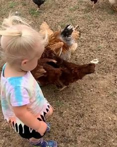 This girl loves her chickens. Read in the link below how to raise friendly chickens. Building A Chicken Coop, Diy Chicken Coop, Chicken Run Ideas Diy, Small Chicken Coops, Chicken Runs, Clean Chicken, Raising Chickens, Cute Little Baby, Baby Chicks
