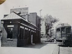 West St Station... Annapolis, MD...Take note of the one cent scale in front of the station and the WB&A sign on the rooftop... Also the old Annapolis bus @ the corner to the left of the train...