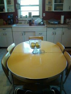 Beautiful Yellow Dinette Set.   Looks just like our table in the 60's when I was growing up.