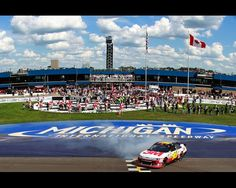 BROOKLYN, MI - AUGUST 19:  Greg Biffle, driver of the #16 3M Ford, celebrates with a burnout after winning the NASCAR Sprint Cup Series Pure Michigan 400 at Michigan International Speedway on August 19, 2012 in Brooklyn, Michigan.