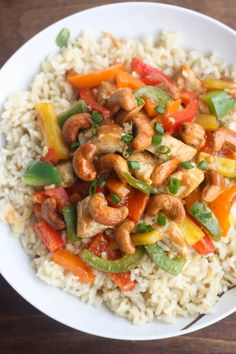 Skinny Asian Chicken Stir-Fry with Honey Roasted Cashews - an easy, healthy, flavorful meal packed with protein and veggies and served over brown rice.   Tastes Better From Scratch